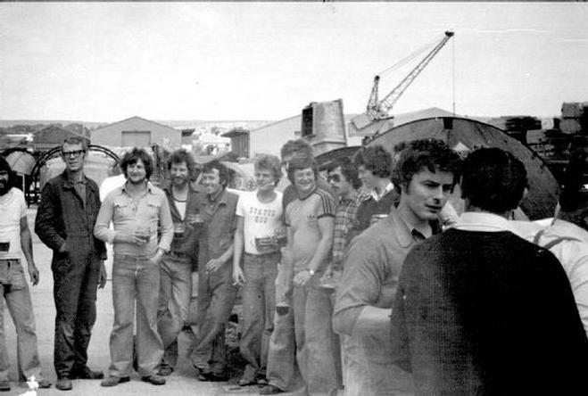 Macintosh HD:Users:rogerbateman:Desktop:RAMUS :Watercraft 5a Some of the workforce enjoying a beer by the far slipway, I think to toast the finish of one of the boats. Slightly before my time there..jpg